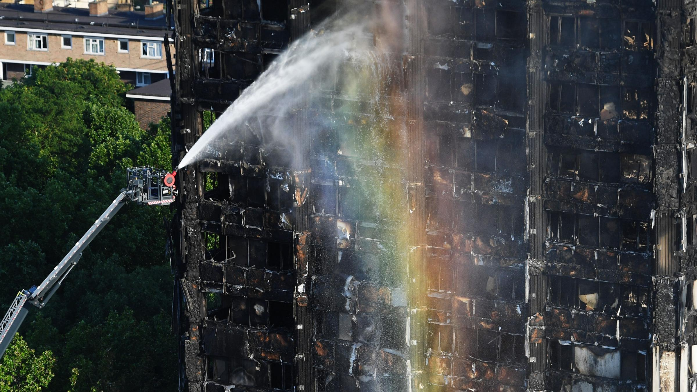 May orders probe into London tower fire; toll rises to 17